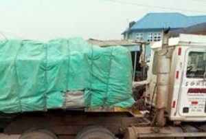 Horror! Truck Crushes Woman To Death After Her Cloth Got Hooked To The Vehicle In Ikorodu (Graphic Photos)